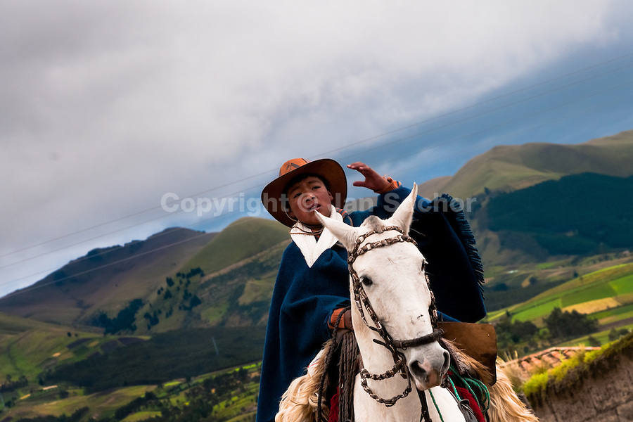 "A young boy rides a white horse during the Inti Raymi festival in Pichincha province, Ecuador, 26 June 2010. Inti Raymi, ""Festival of the Sun"" in Quechua language, is an ancient spiritual ceremony held in the Indian regions of the Andes, mainly in Ecuador and Peru. The lively celebration, set by the winter solstice, goes on for various days. The highland Indians, wearing beautiful costumes, dance, drink and sing with no rest. Colorful processions in honor of the God Inti (Sun) pass through the mountain villages giving thanks for the harvest and expressing their deep relation to the Mother Earth (Pachamama)."