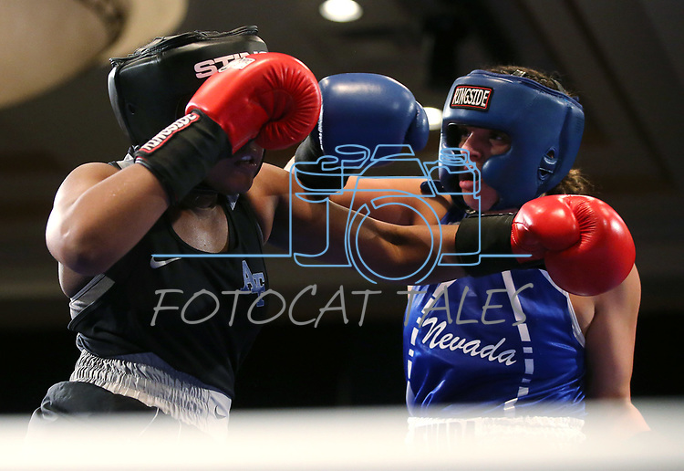 Nevada boxer McKain Murdock and Air Force Academy boxer Ymani Nesmith compete in the National Collegiate Boxing Association action in Reno, Nev. on Friday, Jan. 31, 2020. Murdock won the bout. <br /> Photo by Cathleen Allison