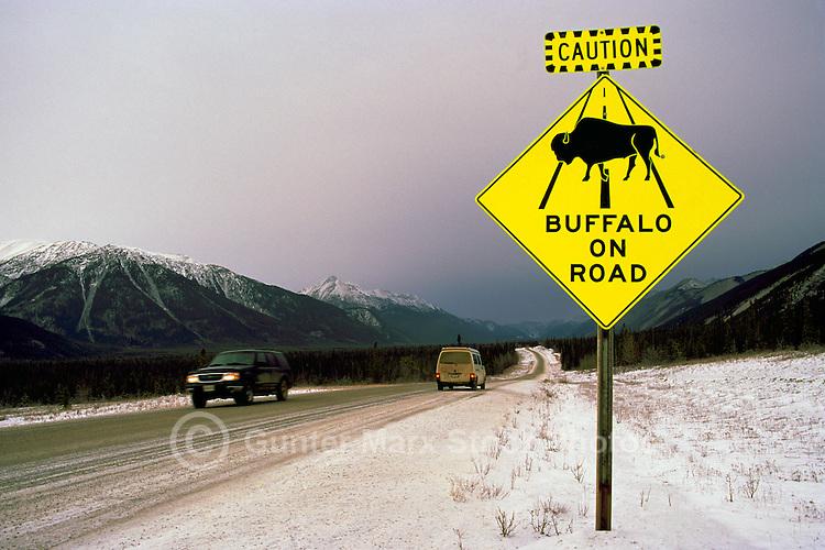 Alaska Highway, Northern Rockies, BC, British Columbia, Canada - Warning Caution Road Sign for Buffalo Animal Crossing, Winter
