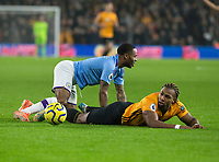 27th December 2019; Molineux Stadium, Wolverhampton, West Midlands, England; English Premier League, Wolverhampton Wanderers versus Manchester City; Adama Traore of Wolverhampton Wanderers lies on the grass after a tackle from Raheem Sterling of Manchester City  - Strictly Editorial Use Only. No use with unauthorized audio, video, data, fixture lists, club/league logos or 'live' services. Online in-match use limited to 120 images, no video emulation. No use in betting, games or single club/league/player publications