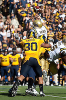 Mcyahl Kendricks and D.J. Holt combine to try and sack Kevin Prince. The California Golden Bears defeated the UCLA Bruins 35-7 at Memorial Stadium in Berkeley, California on October 9th, 2010.
