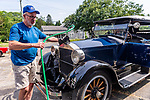 WOODBURY, CT. 16 July 2019-071619 - Steve Bragg of Heflin Alabama stops to fill up his 1922 Stanley Steamer, at the Hotchkissville Firehouse off route 47 in Woodbury on Tuesday. A large group of owners of Stanley Steamers from around the country have gathered driving around the area touring the Litchfield Hills. Bill Shettle Republican-American