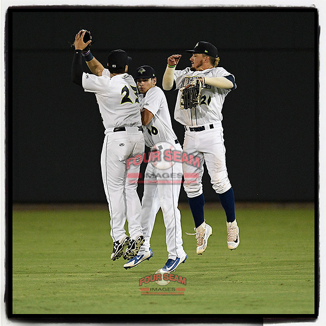 Columbia Fireflies outfielder Zach Rheams (23) gets a celebratory squirt of baby powder from Jay Jabs after Rheams hit a home run in an 11-2 win over the Charleston RiverDogs on Tuesday, August 28, 2018, at Spirit Communications Park in Columbia, South Carolina. (Tom Priddy/Four Seam Images)