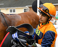 Jockey of Marshal Dan in the Winners enclosure after winning The Shadwell Racing Excellence Apprentice Handicap during Afternoon Racing at Salisbury Racecourse on 16th May 2019