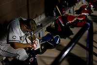Alone in a corner of the dugout, Cheyenne Post 6 centerfielder Brandon Nimmo has a quiet moment with himself before his first at-bat in a legion league game against a team from Twin Falls, Idaho on Tuesday, June 21, 2011, at Powers Field in Cheyenne, Wyo. Nimmo recorded a double on his first at-bat moments later. (Photo by James Brosher)