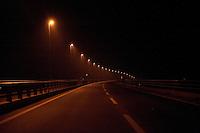 Landscape view of an automobile road with street lights at night following the 311 Tohoku Tsunami in Ishinomaki, Japan  © LAN