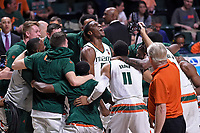 CORAL GABLES, FL - FEBRUARY 18:  Miami center Ebuka Izundu (15) (center) fires up his team prior to the start of the game as the University of Miami Hurricanes defeated the Clemson University Tigers, 71-65, on February 18, 2017, at the Watsco Center in Coral Gables, Florida. (Photo by Samuel Lewis/Icon Sportswire)