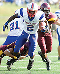 The Gazette DeMatha running back Mac Reed is tackled by his shoestrings as he runs for a large gain during a WCAC match-up at Bishop McNamara on Saturday afternoon.