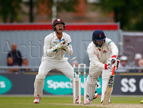 23.05.2016. Old Trafford, Manchester, England. Supersavers County Championship. Lancashire versus Surrey. Surrey wicket-keeper Ben Foakes appeals for a stumping of Lancashire captain, all-rounder Steven Croft but it is not given by the umpire.