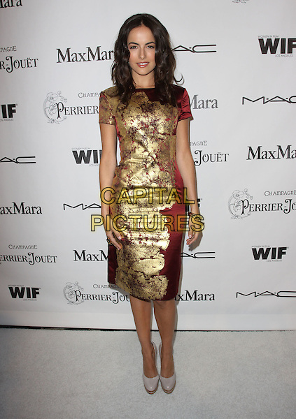 CAMILLA BELLE.3rd Annual Women In Film Pre-Oscar Party held At A Private Residence, Bel Air, California, USA..March 4th, 2010.full length red silk satin gold foil shiny print pattern patterned dress bracelet grey gray patent shoes wooden heel platform heels .CAP/ADM/KB.©Kevan Brooks/AdMedia/Capital Pictures.