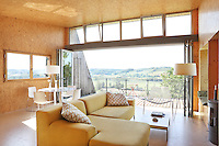 An L-shaped sofa dominates the centre of the living area which has folding windows opening onto a balcony with views over the Lendou Valley
