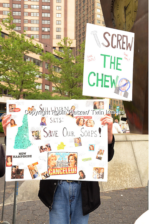 "Signs protesting the cancelation of ABC's ""All My Children"" and ""One Life to Live"" outside Lincoln Center where ABC was presenting it's Upfront of the 2011-2012 Fall Season  on May 17, 2011 in New York City. The protesters were trying to get the advertisers not to adverise on ABC.."