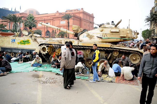 Anti-government protesters take part in demonstrations in Tahrir Square in downtown Cairo, Egypt, Tuesday, Feb. 8, 2011. Protesters appear to have settled in for a long standoff, turning Tahrir Square into a makeshift village with tens of thousands coming every day, with some sleeping in tents made of blankets and plastic sheeting..  Photo by Ahmed Asad
