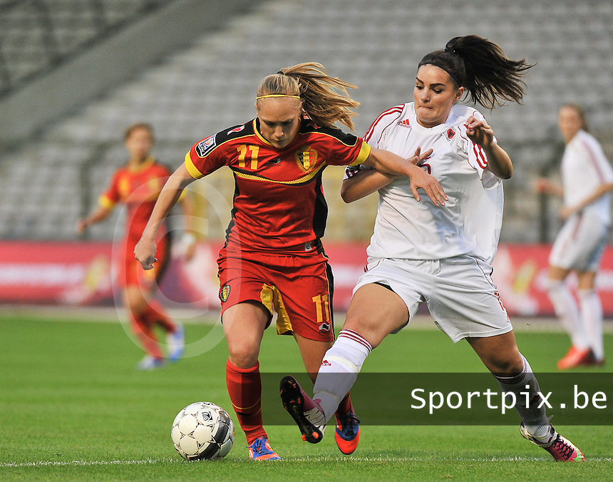 20130921 - BRUSSELS , BELGIUM : Belgian Janice Cayman (11) pictured with tackling Albanian Fitore Govori (right) during the female soccer match between Belgium and Albania , on the first matchday in group 5 of the UEFA qualifying round to the FIFA Women World Cup in Canada 2015 at the Koning Boudewijn Stadion , Brussels . Saturday 21th September 2013. PHOTO DAVID CATRY