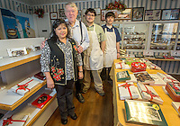 STAFF PHOTO JASON IVESTER --11/26/2014--<br /> Jeanette (from left), Martin, Uriah and Joshua Greer on Wednesday, Nov. 26, 2014, inside Martin Greer's Candies in Garfield.