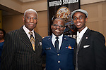 Chaplain Paschal l. Odemokpa stands with military clothes tailor and his son