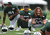 Dylan Donahue #53, right, sticks out his tongue as he stretches during New York Jets Training Camp at the Atlantic Health Jets Training Center in Florham Park, NJ on Monday, Aug. 14, 2017.