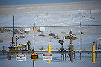 "Oil pipeline infrastructure pops out of the plains near Douglas, Wyo., Thursday, November 22, 2013. The state will require pre-drilling testing of groundwater at sites where hydraulic fracturing, also known as ""fracking"" is used. (Kevin Moloney for the New York Times)"
