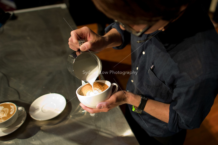 MELBOURNE, AUSTRALIA - JANUARY 09: MASAHIRO ONISHI competing in the 2011 Latte Art Championship held at St Kilda Town Hall on January 9, 2011 in Melbourne, Australia. (Photo by Sydney Low / Asterisk Images)