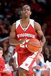 MADISON, WI - OCTOBER 24: Guard Kammron Taylor #23 of the Wisconsin Badgers handles the ball during the red/white scrimmage at the Kohl Center on October 24, 2006 in Madison, Wisconsin. The White team defeated the Red team 72-69. (Photo by David Stluka)