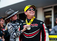 Oct 20, 2019; Ennis, TX, USA; NHRA top fuel driver Billy Torrence celebrates with wife Kay Torrence after winning the Fall Nationals at the Texas Motorplex. Mandatory Credit: Mark J. Rebilas-USA TODAY Sports
