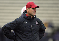 Oct 30, 20010:  Stanford head coach Jim Harbaugh watches his team warm up before the game against Washington.  Stanford defeated Washington 41-0 at Husky Stadium in Seattle, Washington.