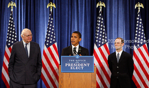 Chicago, IL - November 26, 2008 -- United States President-elect  Barack Obama introduces Paul Volcker, left and Austan Goolsbee, right, during a news conference Wednesday, November 26, 2008, in Chicago, Illinois. .Credit: Frank Polich - Pool via CNP