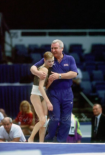 July 26, 1998; New York, NY, USA; (L-R) Artistic gymnast Svetlana Khorkina is comforted by her coach Leonid Arkaev of Russia during trainings at 1998 Goodwill Games New York. Copyright 1998 Tom Theobald