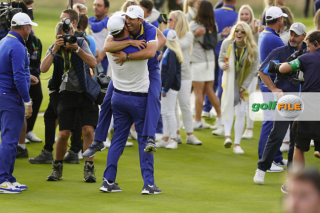 Jon Rahm (Team Europe) Sergio Garcia (Team Europe) after the singles matches at the Ryder Cup, Le Golf National, Ile-de-France, France. 30/09/2018.<br /> Picture Fran Caffrey / Golffile.ie<br /> <br /> All photo usage must carry mandatory copyright credit (© Golffile | Fran Caffrey)