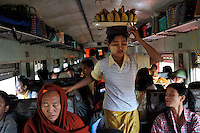 A vendor sells corn on the Mandalay to Rangoon train , Burma Nov 2008.  <br />