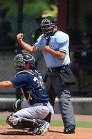 Umpire Zach Tieche makes a call behind catcher Luis Torrens (30) during a game between the GCL Phillies and GCL Yankees 2 on July 22, 2013 at Carpenter Complex in Clearwater, Florida.  GCL Yankees defeated the GCL Phillies 2-1.  (Mike Janes/Four Seam Images)