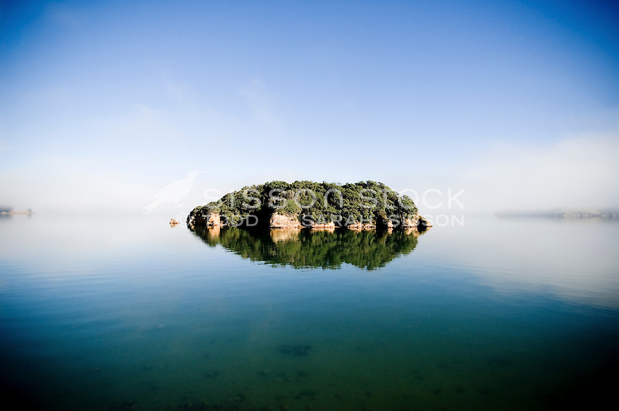 Pudding island reflected on a misty morning, Otago Peninsula, Dunedin
