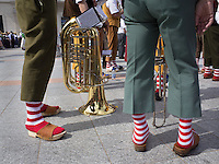 "Switzerland. Ticino. Lugano. MASI LAC.  LAC Lugano Arte e Cultura. Federal Choir Festival in Costume. Musicians wearing colorful socks and clogs. The tuba is the largest and lowest-pitched musical instrument in the brass family. Like all brass instruments, sound is produced by vibrating or ""buzzing"" the lips into a large cupped mouthpiece.  LAC Lugano Arte e Cultura is a new cultural centre dedicated to the visual arts, music and the performing arts. 12.06.2016 © 2016 Didier Ruef"