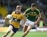 Joe Miniter of Clare in action against Adam Donoghue of Kerry during their Minor Munster final at Killarney.  Photograph by John Kelly.