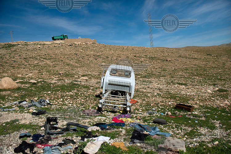 Detritus left on the south side of the Sinjar mountains by fleeing Yazidis who were escaping from an onslaught by Islamic State in August 2014. <br /> <br /> Thousands of Yazidis fled to the mountains when Islamic State (IS) fighters attacked towns and villages around Sinjar in August 2014. Since then Yazidi refugees have been living in precarious conditions with no electricity or running water and children haven't been attending school. Support from the international community has been insufficient and people are dying of hunger and disease. Until December 2014 the mountains were surrounded by IS. Now the southern part of the mountains is still under IS control.
