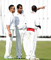 Hornsey captain Chetan Patel (C) in discussion with Paul Weekes (L) and Garfield Struthers during the Middlesex County Cricket League Division Two game between Hornsey and Harrow Town at Tivoli Road, Crouch End on Sat Sept 3, 2011