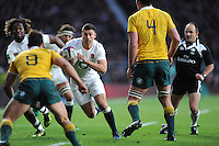 Ben Youngs of England finds space between Nick Phipps and Kane Douglas of Australia to score a try during the Old Mutual Wealth Series match between England and Australia at Twickenham Stadium on Saturday 3rd December 2016 (Photo by Rob Munro)