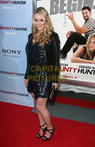 LINDSEY VONN.At the New York City film premiere of 'The Bounty Hunter' at Ziegfeld Theatre in New York City, NY, USA, .March 16, 2010 .arrivals full length blue navy sequined sequin dress sandals clutch bag black leather ruffle jacket .CAP/ADM/PZ.©Paul Zimmerman/Admedia/Capital Pictures