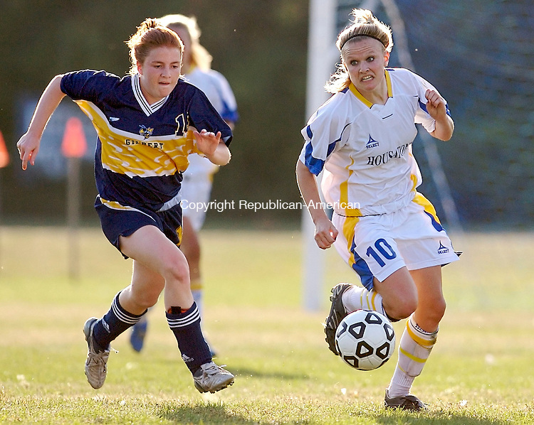 FALLS VILLAGE, CT--02 October 07--100207TJ01 - Gilbert's Kate Williams, left, chases down Housatonic's Maggie Yahn during a 2-2 tie game between Housatonic Regional High School and The Gilbert School in Falls Village, Conn., on Tuesday, October 2, 2007. T.J. Kirkpatrick/Republican-American