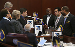 Nevada Senate Democrats caucus on the Senate floor at the Legislative Building in Carson City, Nev., on Friday, April 3, 2015. <br /> Photo by Cathleen Allison