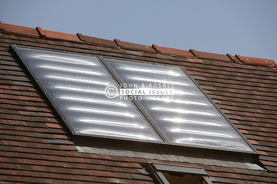 Solar water heating panels on roof of Eco House at The Wintles; Bishop's Castle,