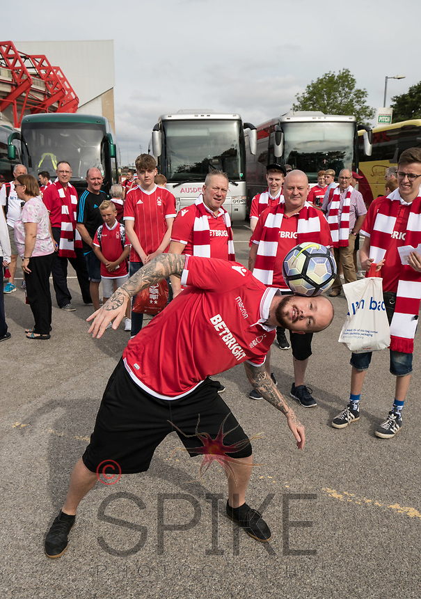 Football freestyler John Whetton entertains the supporters before boarding the buses