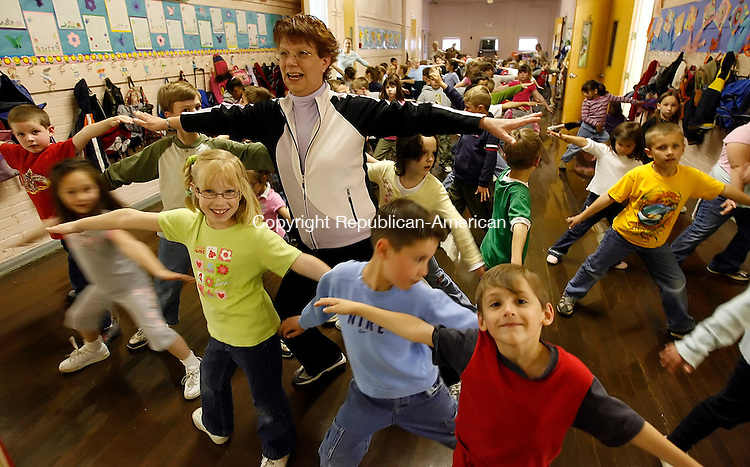 PLYMOUTH, CT-03 May 2006-050306TK08- Wednesday morning  weather forced the cancellation of a scheduled exercise program between Prospect Street Elementary School and the Main Street Eleemtary School. Debbie Kaspar, gym teacher for the  Prospect Street and the Plymouth Center School, leads an exercise program in the Prospect Street Elementary School.  Tom Kabelka Republican-American (Debbie Kaspar)