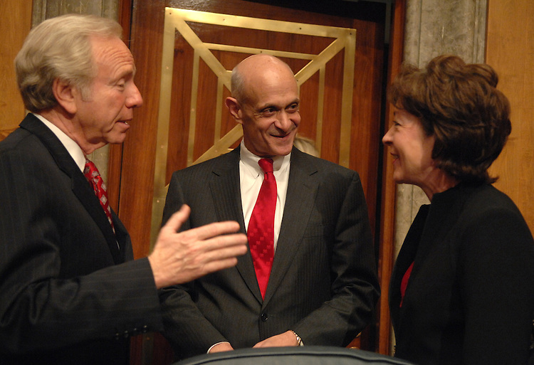 Chairman of the Homeland Security and Governmental Affairs Committee Joe Lieberman, D-Conn., left, and ranking member Sue Collins, R-Me., talk with Homeland Security Secretary Michael Chertoff, before a hearing on the Department's budget request for FY2008.