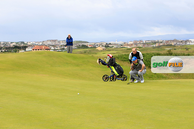 Ian Moore (Dunmurry) on the 3rd green during Round 1 Matchplay of the North of Ireland Amateur Open Championship at Royal Portrush, Dunluce Course on Wednesday 15th July 2015.<br /> Picture:  Golffile | Thos Caffrey