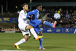 12 December 2014: UCLA's Abu Danladi (GHA) (right) and Providence's Brandon Adler (left). The University of California Los Angeles Bruins played the Providence College Friars at WakeMed Stadium in Cary, North Carolina in a 2014 NCAA Division I Men's College Cup semifinal match. UCLA won the game 3-2 in overtime.