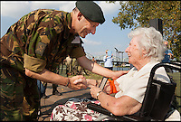 BNPS.co.uk (01202 558833)<br /> Pic: MichaelvanCaspel/BNPS<br /> <br /> ***Please Use Full Byline***<br /> <br /> Helen Wilson (93) with Lieutenant-general Mart de Kruif the Commander of the Royal Netherlands Army. The ceremony took place at Thompson Bridge, Grave, Netherlands. <br /> <br /> <br /> A resistance worker who survived capture, torture and a death sentence for helping to hide British airmen during the infamous Battle of Arnhem has finally been recognised for her heroism.<br /> <br /> Helen Willson, a British resident, has been presented with the prestigious Dutch Resistance Cross for her little-known acts of bravery 70 years ago.<br /> <br /> She was a member of a resistance cell that spied on the Germans, brought food to Jewish people in hiding and then assisted the British paratroopers during the Operation Market Garden in September 1944.