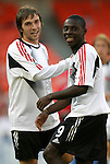 8 May 2004: Bobby Convey (15) and Freddy Adu (9) check out the attractive national anthem singer while warming up before the game. DC United tied the Columbus Crew 1-1 at RFK Stadium in Washington, DC during a regular season Major League Soccer game...