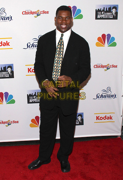 """HERSHEL WALKER .""""The Celebrity Apprentice"""" season finale at the American Museum of Natural History, New York, NY, USA, .10th May 2009..full length black suit  print tie .CAP/ADM/PZ.©Paul Zimmerman/Admedia/Capital Pictures"""