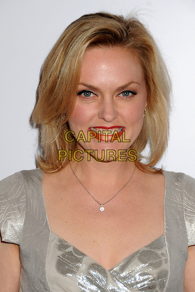 ELANIE HENDRIX .24th Annual Genesis Awards - Arrivals held at the Beverly Hilton Hotel, Beverly Hills, California, USA, 20th March 2010..portrait headshot smiling lipstick red necklace silver  metallic shiny .CAP/ADM/BP.©Byron Purvis/AdMedia/Capital Pictures.